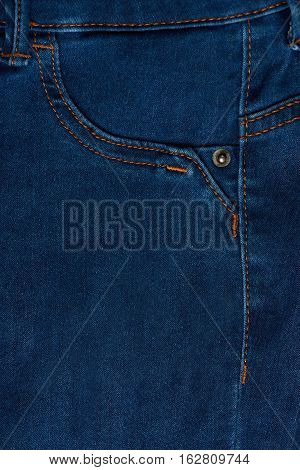 Pocket of classic blue jeans close up. Macro of empty jeans pocket