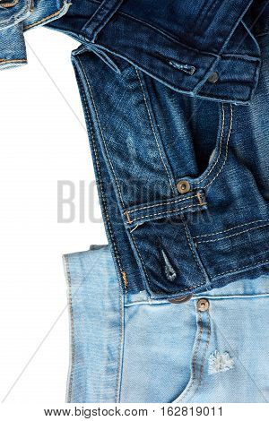 Dark blue jeans border background with white copy space