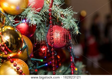 Closeup Christmas Tree With Decorative Balls And Garland