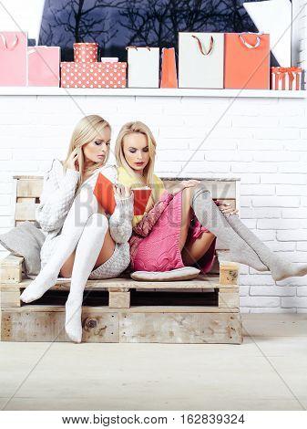 Girls Read Book On Sofa