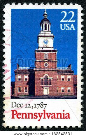 UNITED STATES OF AMERICA - 1ST MARCH 2016: A used postage stamp (circa 1987) commemorating the 200th Anniversary since Pennsylvania beaome the second state to ratify the Constitution circa 1987.