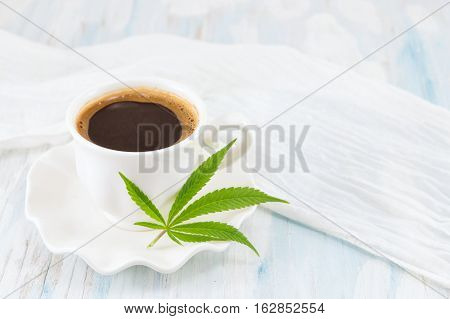 Hot Coffee And Marijuana Leaves