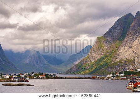 Norway Village On A Fjord. Nordic Cloudy Summer Day.