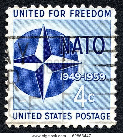 UNITED STATES OF AMERICA - CIRCA 1959: A used postage stamp from the USA commemorating the 10th year of the formation of Nato circa 1959.