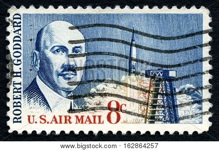 UNITED STATES OF AMERICA - CIRCA 1964: A used postage stamp from the USA commemorating the work of engineer and inventor Robert H. Goddard - creator of the first liquid-fueled rocket circa 1964.