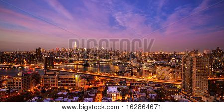 Aerial view of Brooklyn and Manhattan Bridge over East River and midtown Manhattan Skyline from Brooklyn Heights