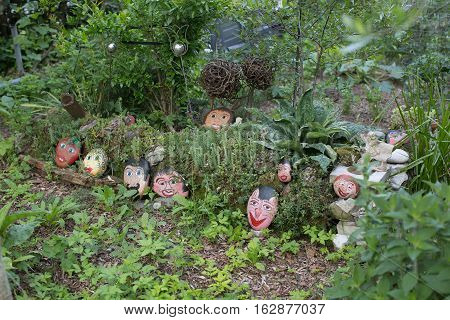 Benabbio Italy-June 3 2015. View of a garden decorated with rocks painted with faces in the historic village of Benabbio in the Province of Lucca Tuscany Italy