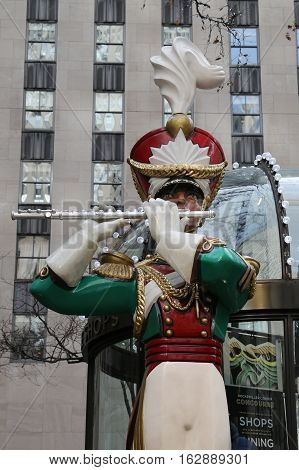 NEW YORK CITY- DECEMBER 15, 2016: Wooden toy soldier flute player Christmas decoration at the Rockefeller Center in Midtown Manhattan