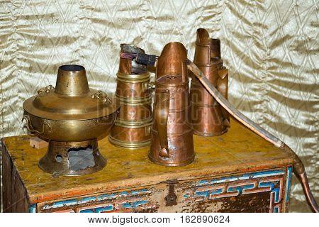 Items ancient Mongolian home utensils, handmade of metal.