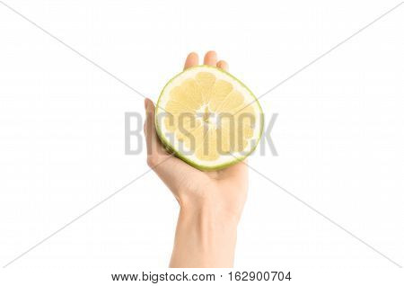 Healthy Eating And Diet Topic: Human Hand Holding A Half Sweetie Isolated On White Background In The