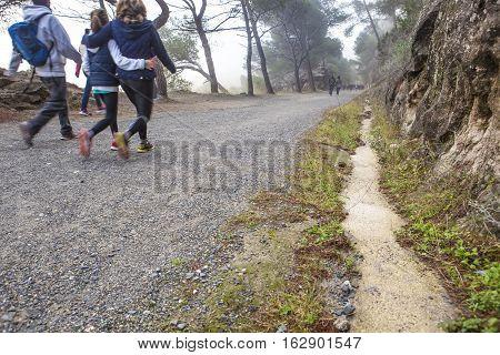 Family walking by Caminito del Rey path Malaga Spain. Motion blurred shot