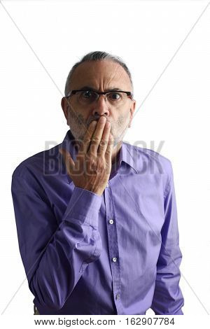 Man with hand in mouth with a white background