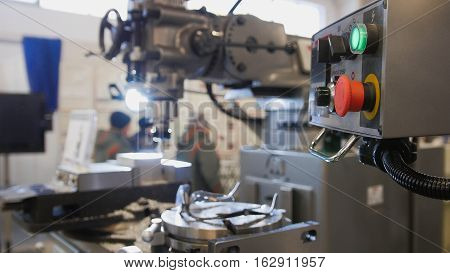 lathe machine at factory - machinery industry, close up view