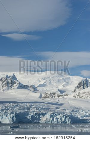 glaciers and mountains on the coast of the Antarctic Peninsula sunny day