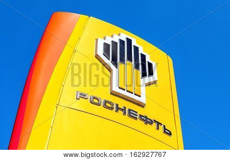 SAMARA RUSSIA - APRIL 16 2016: The emblem of the oil company Rosneft against the blue sky background. Rosneft is one of the largest russian oil companies