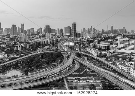 Black and White, Bangkok highway intersection with city downtown background, Thailand