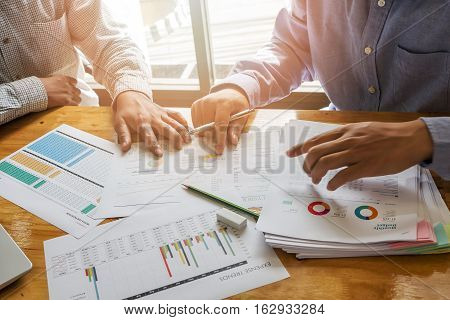 Two businessmen discussing together in meeting room