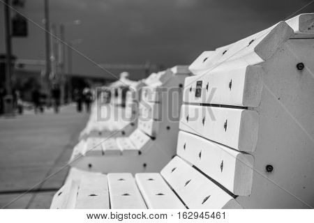 Corpus Christi Texas USA black and white Park Bench along the long sea wall along the Gulf Coast a nice vacation spot to relax
