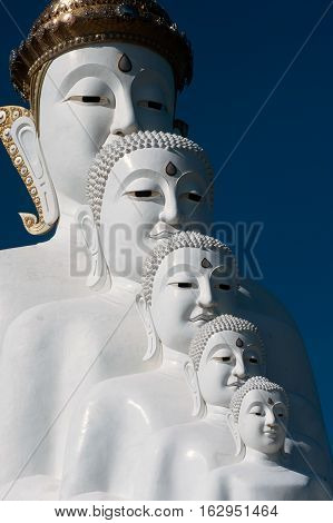 PHETCHABUN ,THAILAND-DECEMBER 18 ,2016 :The five-stacked white Buddha,especially with a clear blue sky as background in Wat Pha Sorn Kaew,it is certainly one of the most beautiful temples on Khao Khaw, Phetchabun Province, Northern of Thailand.
