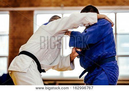 judoka man wrestlers heavyweight in judo competition
