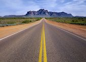 stock photo of superstition mountains  - Desert wilderness road leading to mountain - JPG