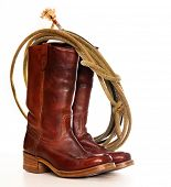 picture of wrangler  - vertical image of a pair of brown cowboy boots and a Lasso on a white background - JPG