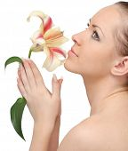 stock photo of beautiful woman face  - beautiful woman with lily flower on a white background - JPG