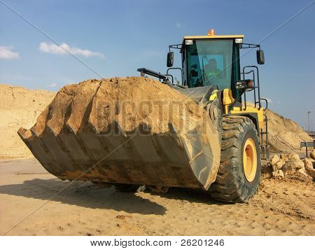 Backhoe loader with loaded soil