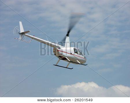 Silver chopper in the air