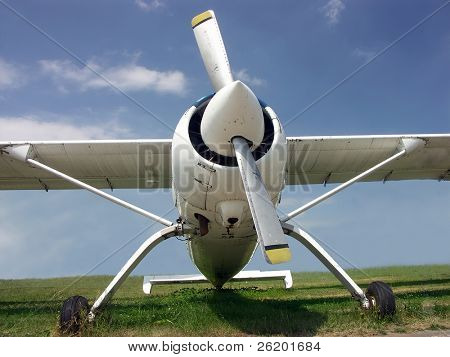 Airplane parked on meadow