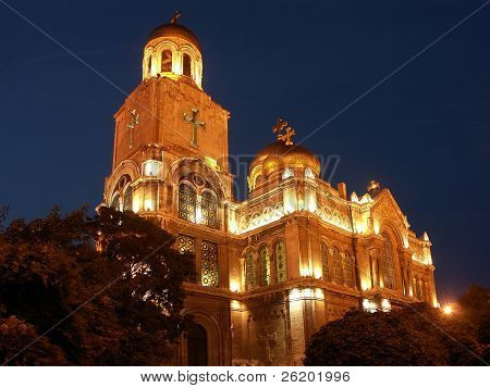 The Assumption Cathedral of Modern Byzantine style in Varna, Bulgaria with golden domes, illuminated by night