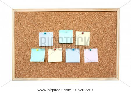 Seven colorful blank post-it notes affixed to the corkboard - isolated on white