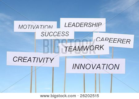 Set of seven white transparents with business slogans - Innovation, Creativity, Teamwork, Career, Success, Motivation and Leadership over blue sky