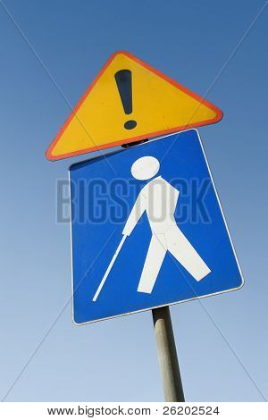 Blind person road traffic sign over clear blue sky