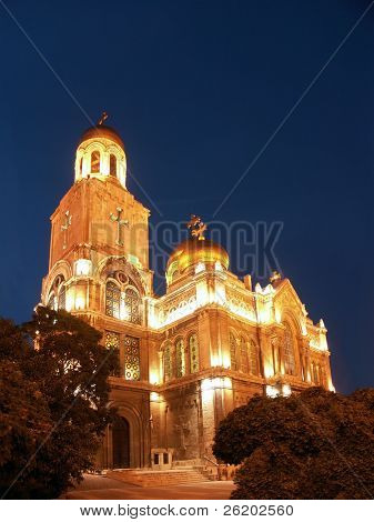 The Assumption Cathedral of Modern Byzantine style with golden domes illuminated by night, Varna, Bulgaria