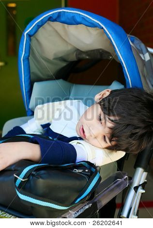 Disabled Five Year Old Boy In Wheelchair