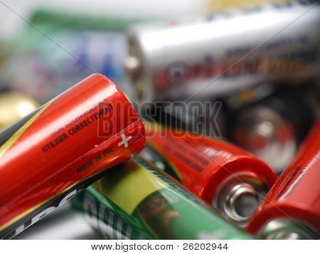 Closeup of pile of used alkaline batteries