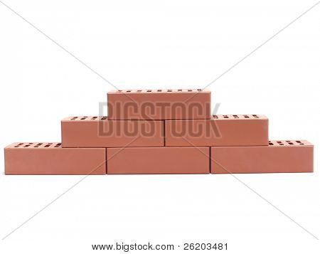 Partial wall made of perforated bricks over white background
