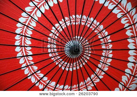Red Japanese umbrella with spiral floral design