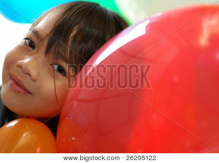 Little girl with balloons, red area for copy space