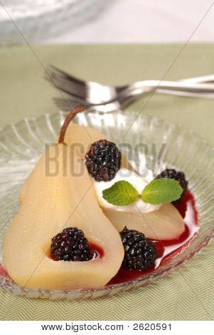 Bartlett Pear Poached In Wine With A Blackberry Sauce
