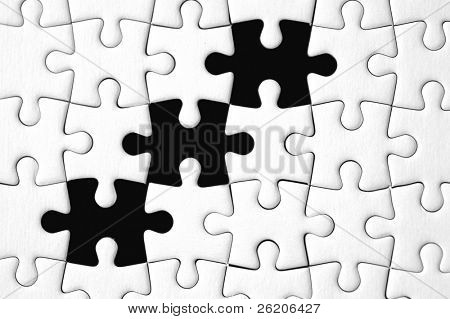 White puzzle with three missing pieces