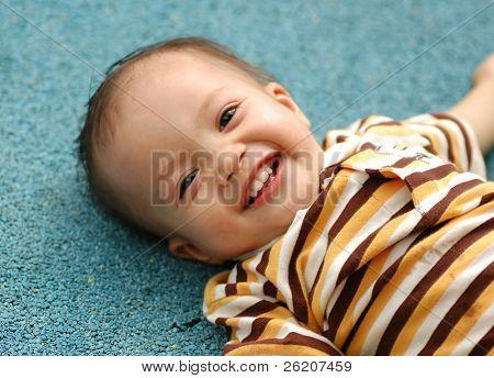 Baby boy giggling