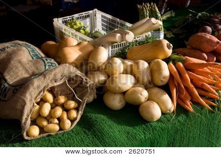 Fresh Vegetables On Display For Sale On A Market Stall