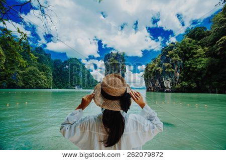 poster of Traveler Woman With Holding Hat Joy Relaxing Looking Beautiful View Amazing Nature Landscape Of Jame