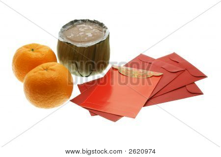 Chinese New Year Cake, Oranges And Red Packets