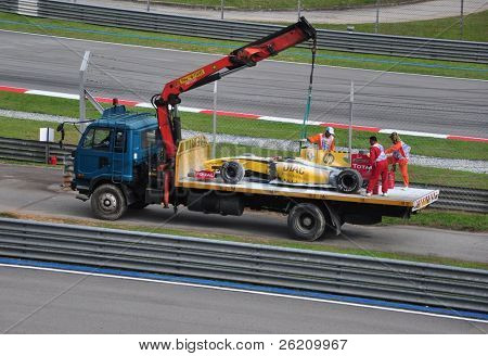 SEPANG, MALAYSIA - APRIL 4 : Vitaly Petrov's car was carried on a truck due to gearbox failure during Petronas Malaysian Grand Prix at Sepang F1 circuit April 4, 2010 in Sepang, Malaysia
