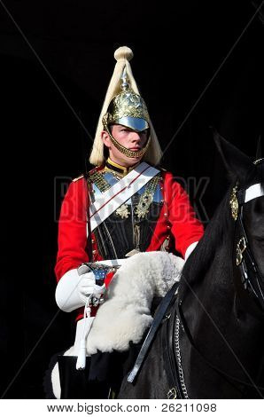 LONDON â?? SEPTEMBER 24: An unidentified Royal Guard on horse is on guard at the Admiralty House on September 24, 2011 in London, England.  Two mounted guards are posted every day from 10 a.m. to 4 p.m. and are relieved every hour.