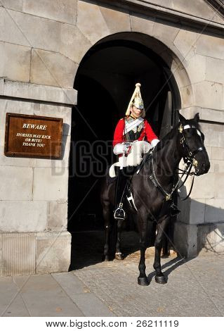 LONDON â?? SEPTEMBER 24: A cavalry trooper is posted outside the Horse Guards on September 24, 2011 in London, England. The Queens Cavalry was formed for 130 years ago.
