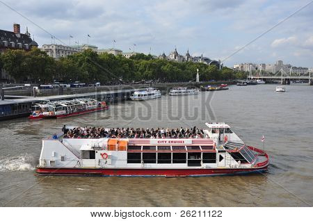 LONDON â?? SEPTEMBER 24: A City Cruises tour boat sails on the Thames River on September 24, 2011 in London, England. Thames is the longest river in England with 346 km long.